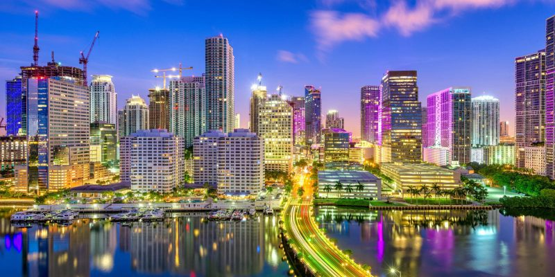 Miami, Florida, USA downtown skyline over Biscayne Bay at night.