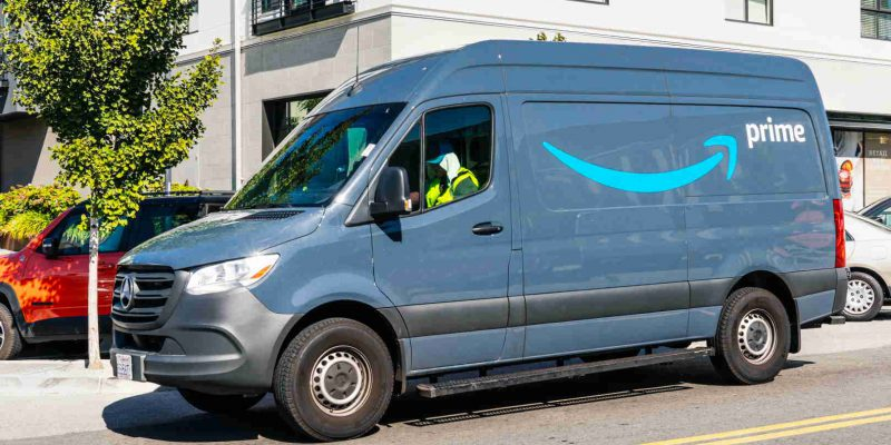 August 24, 2019 San Mateo / CA / USA - Amazon van branded with the Amazon Prime logo, making deliveries in San Francisco bay area